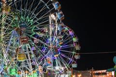 过山车好久夜间festval照明设备的庆祝 免版税库存图片