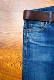 年迈的蓝色牛仔裤 免版税图库摄影