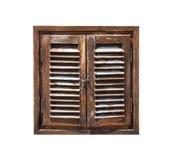 年迈的被风化的木窗口快门 免版税库存图片