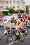 运动员在自行车竞争时 免版税图库摄影