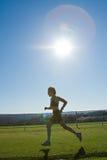 运动员女性运行中 免版税库存照片