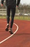 运动员热身的跑道 免版税库存图片
