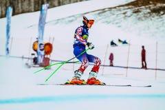 运动员男性滑雪者在种族以后结束下坡从在俄国杯期间的山在高山滑雪 免版税库存照片