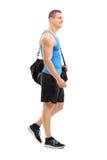 年轻运动员运载的体育袋子 库存照片