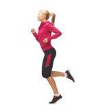 运动妇女赛跑或跳跃 免版税库存照片