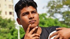 运动男性足球运动员认为 图库摄影