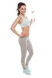 运动的从一个瓶的女孩饮用水在锻炼以后,健身训练,隔绝在白色背景 库存照片