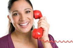 运算符电话红色微笑的年轻人 图库摄影