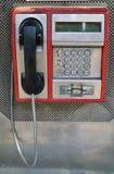 运行在硬币的一个减速火箭的投币式公用电话 免版税库存照片