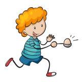 运行在蛋和匙子种族的男孩 库存图片