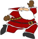 运行的圣诞老人 库存照片