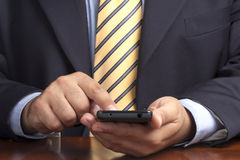 运转接触智能手机的商人手 库存图片