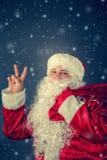 运载克劳斯礼品圣诞老人 免版税库存图片