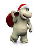 运载圣诞老人袋子的动画片河马 免版税库存图片
