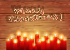 运载圣诞节克劳斯礼品例证晚上圣诞老人向量 在木背景的灼烧的蜡烛 Celebra 免版税图库摄影