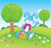 运载复活节篮子场面的复活节兔子 库存照片