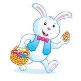运载复活节篮子用鸡蛋的兔宝宝 免版税图库摄影