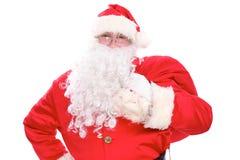 运载大袋子的亲切的圣诞老人,隔绝在白色背景 免版税库存照片