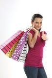 运载女孩购物的亚洲袋子少年 免版税库存图片