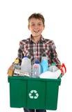 运载愉快的回收的垃圾的男孩 库存图片