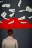 运载红色伞的女性执行委员背面图的综合图象 免版税库存图片