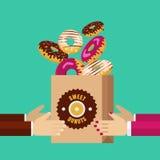 运载纸组装用巧克力的男人和妇女手的白色 库存图片