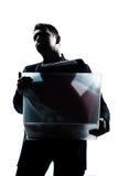 运载重的箱子的商人画象 库存图片