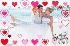 运载他美丽的白肤金发的妻子的英俊的新郎的综合图象 免版税库存照片