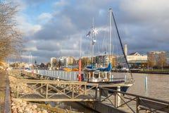 运送在气氛河的码头在图尔库 库存照片
