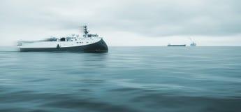 近海调查船在繁忙的油田北海 库存照片