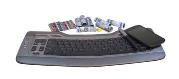 近金钱到键盘和电话 库存照片