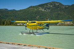 返回从观光旅游的水上飞机 库存图片