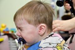 这一岁儿童第一次的发型 库存照片
