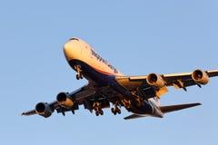 这个NCA的波音747-8日落到来 库存图片