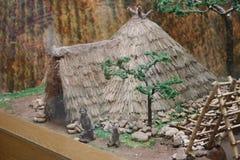 这是原始的man's大厦的复制品在红山文化博物馆在中国 库存照片