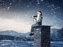这里圣诞老人 混合画法 库存照片