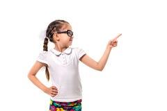 这里您的文本 指向空的空间的小女孩 图库摄影