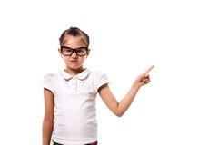 这里您的文本 指向空的空间的小女孩 免版税库存照片