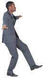 进行一次平衡操作的商人 免版税库存图片