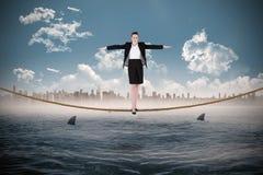 进行一次平衡操作的女实业家的综合图象 免版税图库摄影