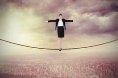 进行一次平衡操作的女实业家的综合图象 免版税库存图片