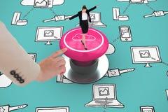 进行一次平衡操作的女实业家的综合图象 免版税库存照片