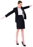 进行一次平衡操作的女实业家 免版税图库摄影