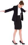 进行一次平衡操作的女实业家 免版税库存照片