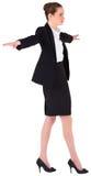 进行一次平衡操作的女实业家 免版税库存图片