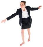 进行一次平衡操作的女实业家 库存照片