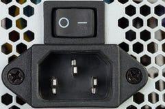 连接器和关闭电源的按钮对compu 免版税库存照片