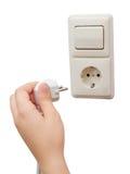 连接插座的手到插口 库存图片