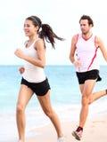 连续人员: 夫妇赛跑者 库存照片