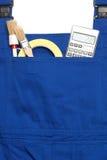 连衫裤工作服概念,搜寻得心应手的人、计算器和P 库存图片